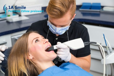 Dentist Scanning The Teeth Of Patient With Cerec Scanner